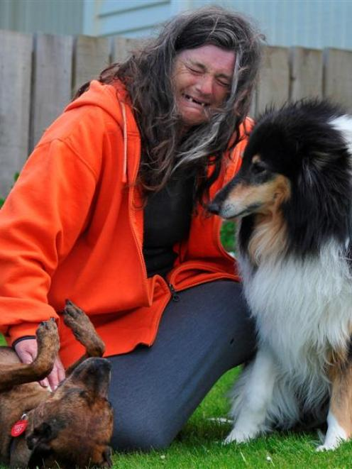 Housing NZ tenant Taina Goodwillie, with her dogs Angel (left) and Bracken, in Brockville...