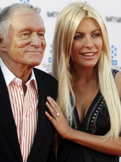 Hugh Hefner and his fiancee, Playboy Playmate Crystal Harris. File photo by Reuters.