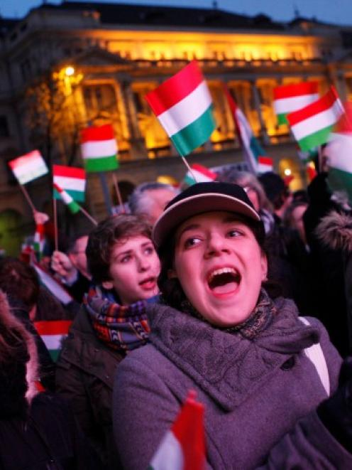 Hungarians shout slogans during a demonstration against the far-right opposition Jobbik party in...