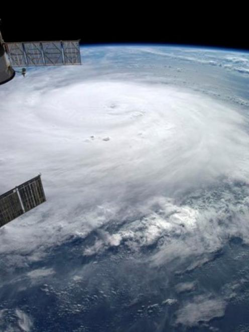 Hurricane Gonzalo is seen over the Atlantic Ocean in this NASA image taken by astronaut Alexander...