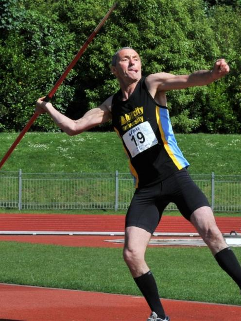 Ian Craven (Hill City-University) throws the javelin 26.43m during the successful defence of his...