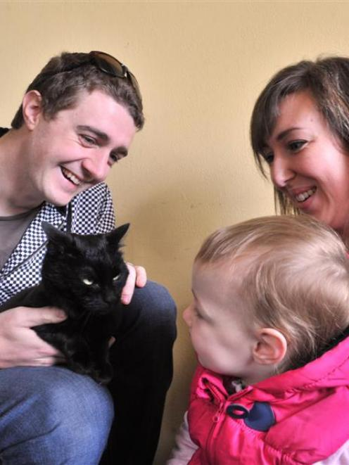 Ian, Naomi and Bethany (2) Simpson reunite with their cat, Riley, at the Otago SPCA haven on...