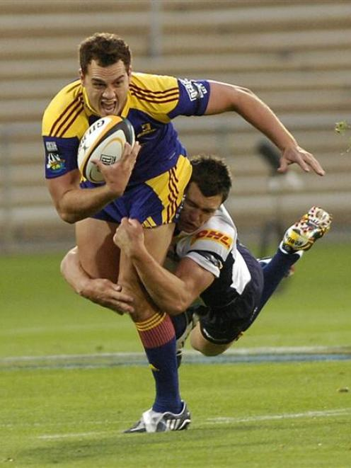 Impressive young fullback Israel Dagg is dragged down by Brumbies back Adam Ashley-Cooper at...
