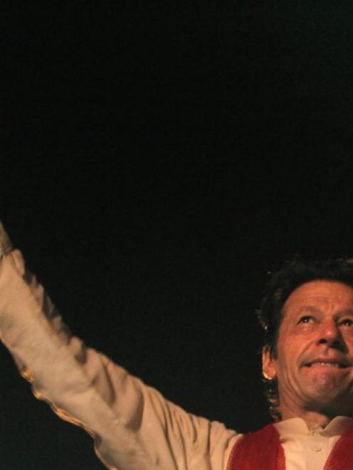 Imran Khan gestures to his supporters during a Freedom March in Islamabad. REUTERS/Faisal Mahmood