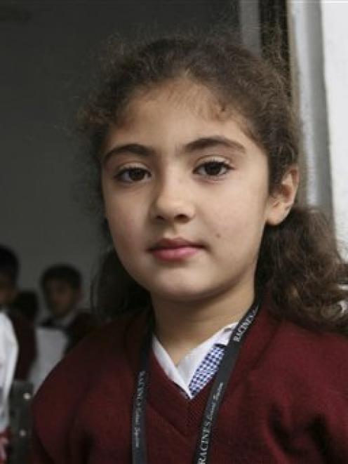 In this AP image taken on December 3, 2009, 8-year-old Pakistani student Saira Khan, is seen...