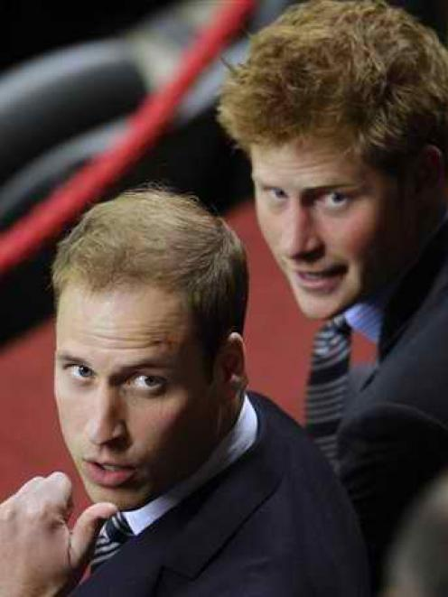 In this June 2010 file photo, Britain's Prince William, left, and Britain's Prince Harry, right,...
