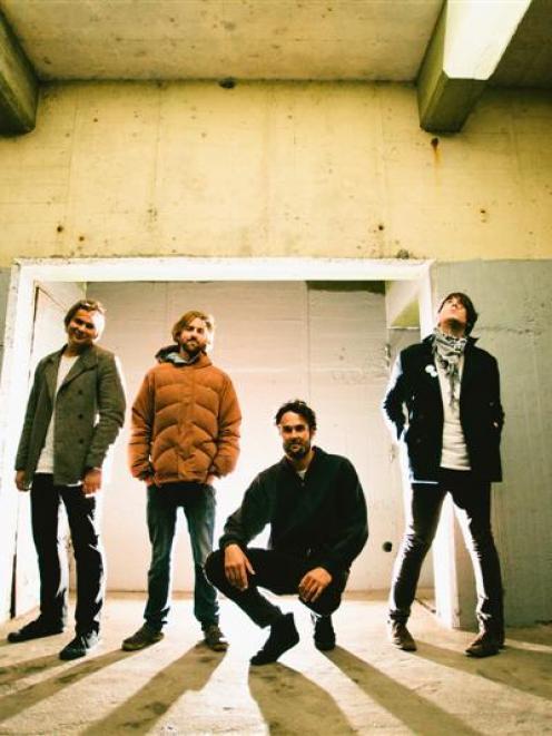 Independent . . . The Julian Temple Band, (from left) Alex Vaatstra, Paul McLennan-Kissel, Julian...