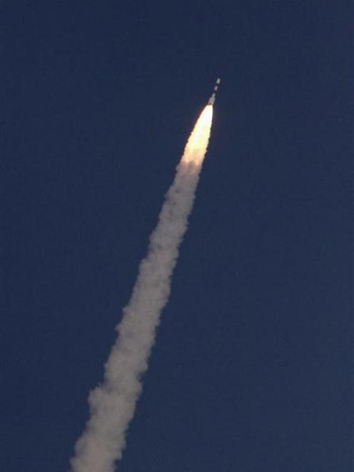 India's Polar Satellite Launch Vehicle, carrying the Mars orbiter, blasts off from the Satish...