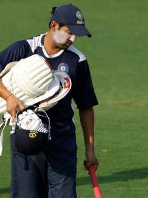Indian batsman Gautam Gambhir arrives for a session at the nets in Nagpur, India. (AP Photo...