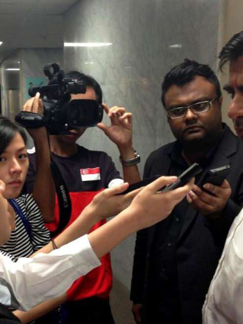 Indian High Commissioner to Singapore T.C.A. Raghavan (R) speaks to journalists about the...