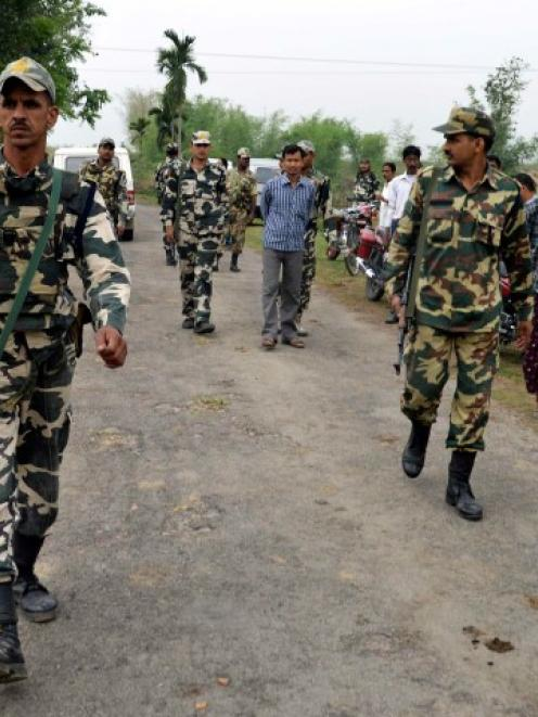 Indian security personnel patrol the attack-hit area of the Balapara village in the northeastern...