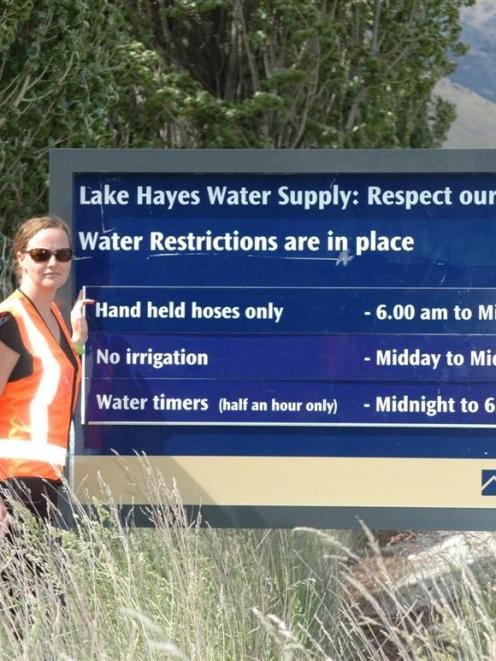 Infrastructure support team leader Sarah Thomson next to one of three signs recently installed to...