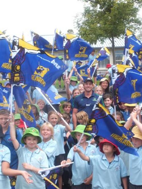 Injured Highlanders fullback Ben Smith is surrounded by hundreds of excited rugby fans at...