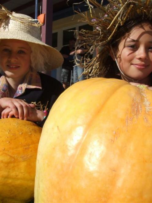 Inspecting entries in the pumpkin-growing competition at Ardgowan School are pupils Megan McLeod ...