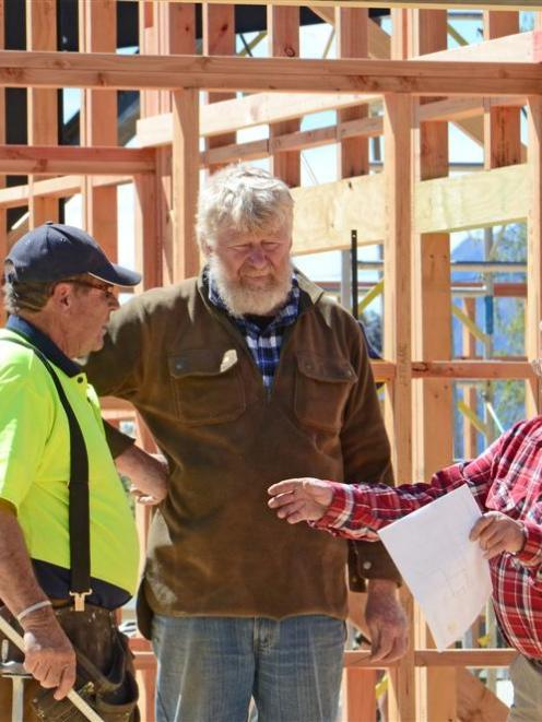 Inspecting progress on the $1.5 million  extension project are (from left) Breen Construction...