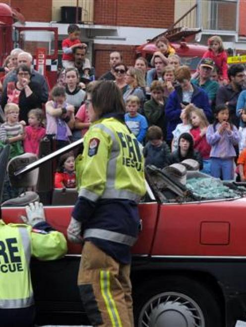 Interested spectators of all ages watch a firefighting  display at the Dunedin Central Fire...