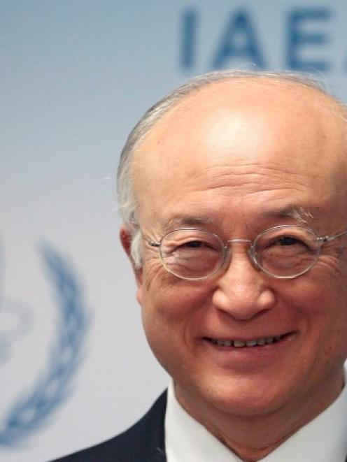 International Atomic Energy Agency Director General Yukiya Amano addresses the media after a...