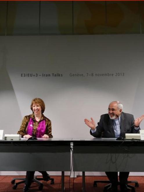 Iranian Foreign Minister Mohammad Javad Zarif (right) gestures next to European Union foreign...