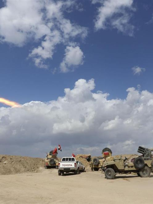 Iraqi security forces and Shi'ite fighters clash with Islamic State militants in Salahuddin...