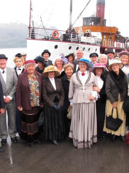 Direct descendants of naval architect Hugh McRae, designer of TSS  Earnslaw, stand with extended...