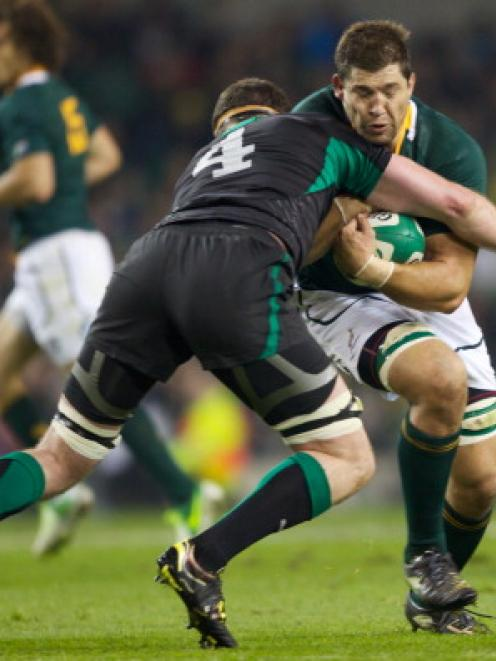 Ireland's Donnacha Ryan tackles South Africa's Willem Alberts during their rugby union test at...