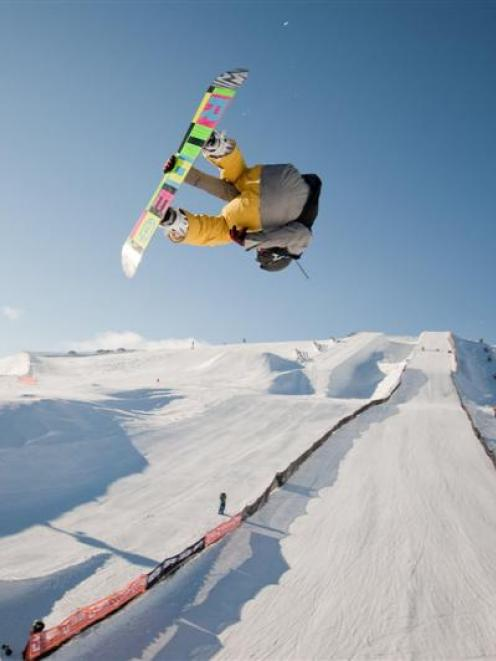Irish snowboarder Seamus O'Connor (13) wins the open men's snowboard event at the Electric...