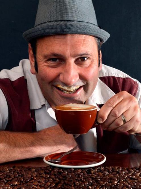 Ironic Cafe co-owner Steve Wilson samples his award-winning Evoke coffee blend yesterday. Photo...
