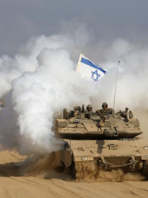 Israel pulled its ground forces out of the Gaza Strip and started a 72-hour ceasefire with Hamas...