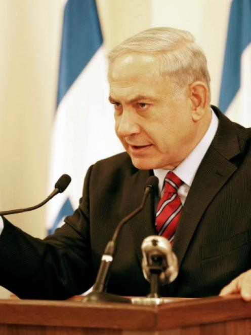 Israel's Prime Minister Benjamin Netanyahu gestures during a news conference in Tel Aviv about...