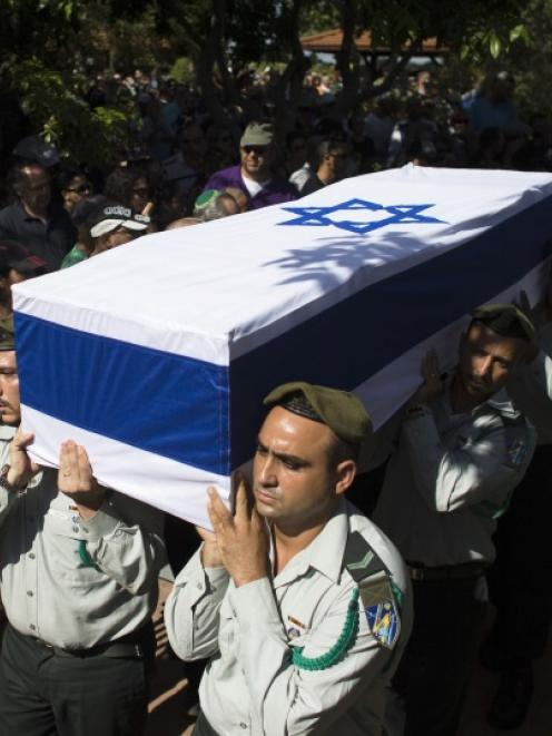 Israeli soldiers carry the flag-draped coffin of fallen reserve Israeli soldier Yair Ashkenazy...