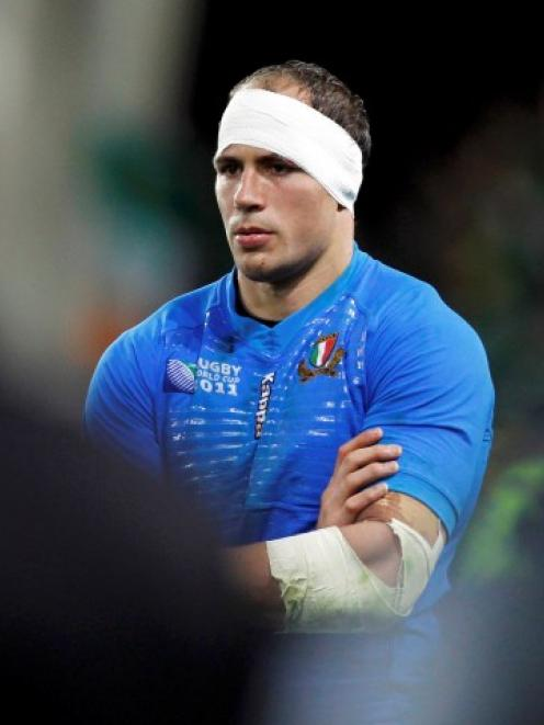 Italy captain Sergio Parisse stands on the field after his team lost their Rugby World Cup Pool C...