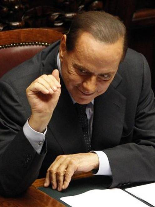Italy's Prime Minister Silvio Berlusconi is under renewewd pressure. REUTERS/Max Rossi