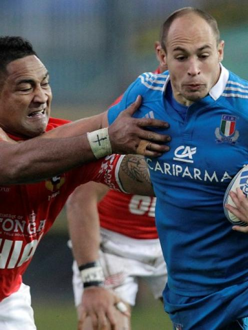 Italy's Sergio Parisse (R) tries to get past Tonga's Halani Aulika during their rugby test at...