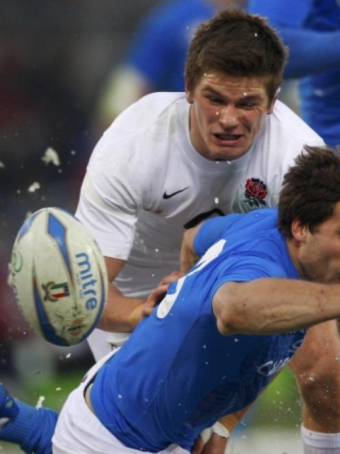 Italy's Tommaso Benvenuti challenges England's Owen Farrell. REUTERS/Max Rossi