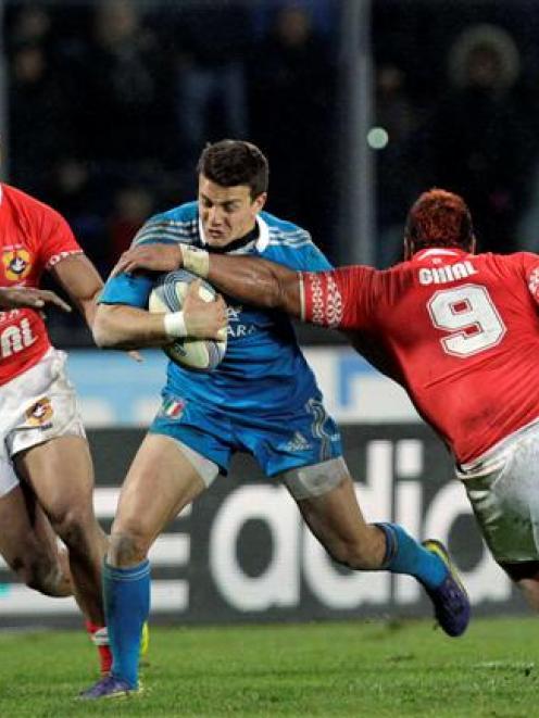 Italy's Tommaso Iannone fights for the ball with Tonga's Taniela Moa . REUTERS/Alessandro Garofalo