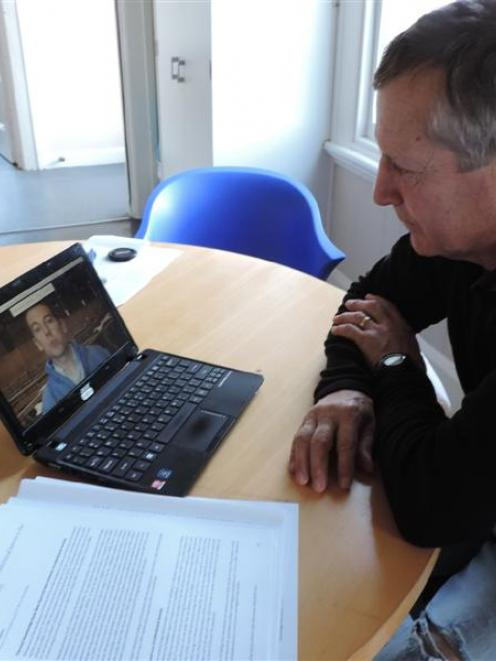 Ivan Holloway studies a video on foot-and-mouth disease at Vetlife Oamaru in preparation before ...