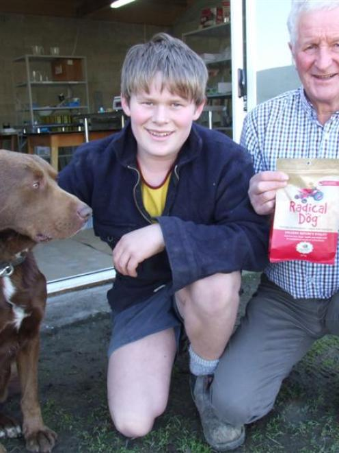 Jack Newlands (14) and his grandfather John Newlands, with Cop the dog, outside the Radical Dog...