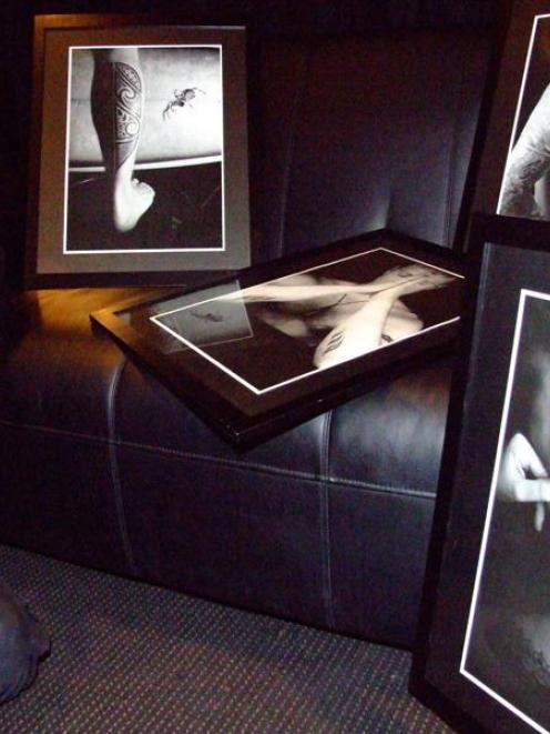 Jackie (Jax) Gay, of Still Vision Photography, studies some of her work which featured in the...