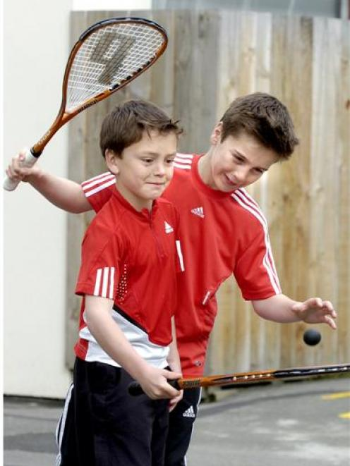 Jamie (left) and Josh Oakley joke around ahead of their opening matches in the E grade national...