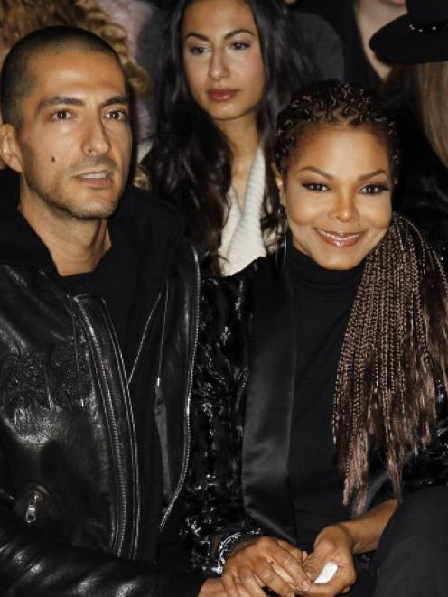 Janet Jackson and Wissam Al Mana attend the Roberto Cavalli Autumn/Winter 2013 collection at...