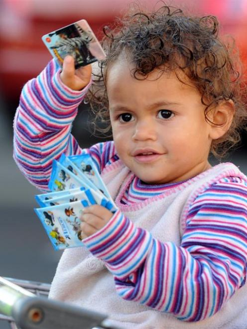 Jasmine Albrandt (2), of Waikouaiti, holds her DreamWorks Heroes action cards in central Dunedin....