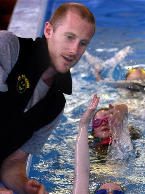 JC Swimming School instructor Kurt Crosland teaches Andersons Bay School pupils (from bottom)...