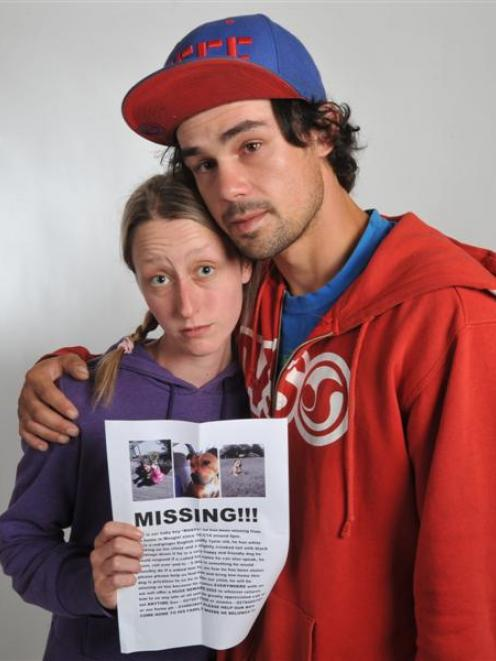 Jemma Calder and Gavin Howie, of Mosgiel, with a poster for their missing dog Rusty. Photo by...