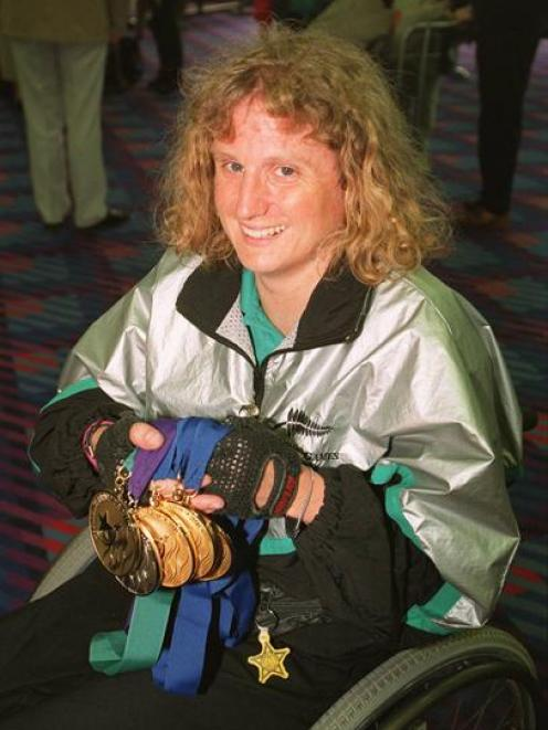 Jenny Newstead shows off the medals she won at the 1996 Olympic Games. Photo from the <i>ODT</i>...
