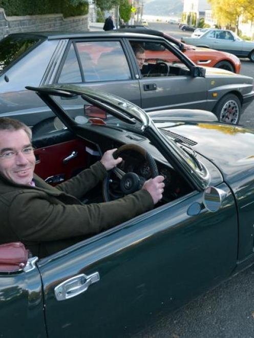 Jeremy Smith, of Dunedin, warms up his 1971 Triumph Spitfire before the start of the Autumn...