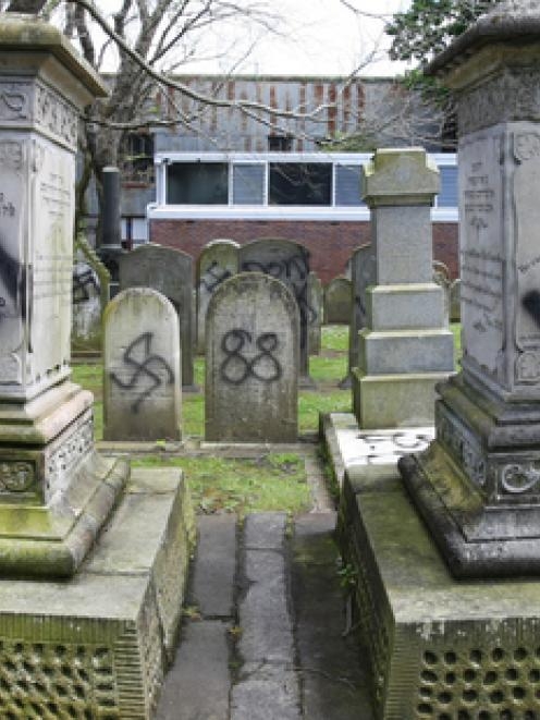 Jewish graves were desecrated with Nazi emblems. Photo / Chris Gorman.