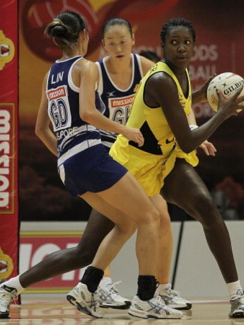 Jhaniele Fowler (in yellow) in action for Jamaica against Singapore last year. Photo Getty