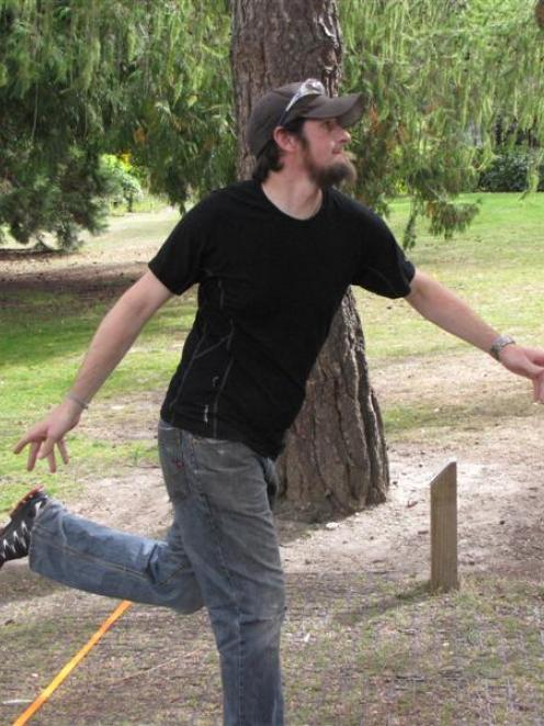Jim Hemingway, of Queenstown, checks the flight of his throw at the Queenstown Classic Disc Golf...