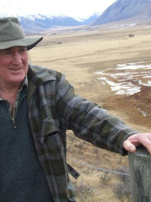 Jim Morris at home in the Ahuriri Valley. To the left is a wetland area he has fenced off for...