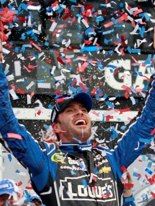 Jimmie Johnson celebrates in victory lane after winning the NASCAR Sprint Cup Series Daytona 500...